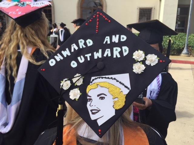 Onward and outward grad cap